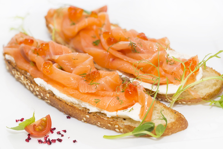 adorned: sandwiches with salmon caviar and greens adorned