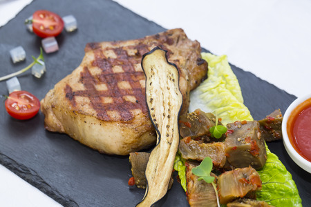 volcanic stones: steak with steamed vegetables on a hot volcanic stones