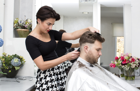 coiffeur: The young man at the hairdresser salon hairstyle make model