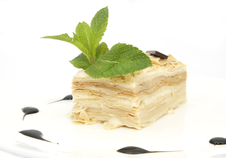 layered: layered dessert on a white background decorate with mint