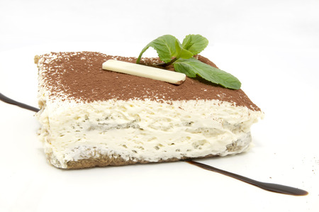 chocolate mint: piece of cake decorated with cream and chocolate mint
