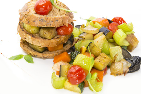 unprocessed: steamed vegetables, tomatoes celery eggplant with rye rolls Stock Photo