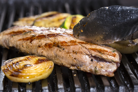 cook out: cooking beef steak on a grill in the restaurant