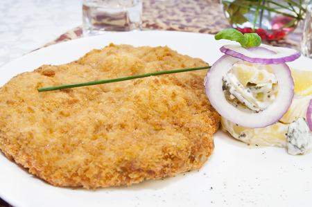 schnitzel: Schnitzel vegetable salad at restaurant