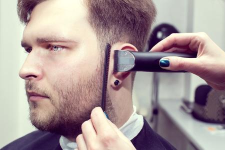 barbershop: mens haircut in the salon barbershop beard closeup