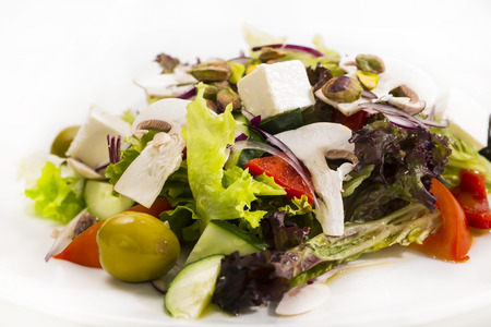 aliments: Greek salad on a table in a restaurant Stock Photo