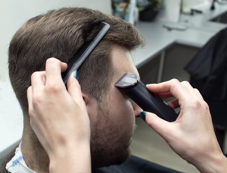 haircut: mens haircut in the salon barbershop beard closeup