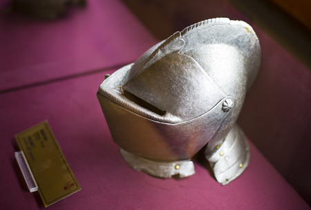 chivalry: ISTANBUL, TURKEY - OCTOBER 14, 2015: Metal helmet of the medieval knightt. Museum Military, Istanbul, Turke
