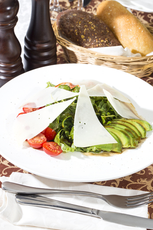 the greens: shrimp salad and greens on a white background
