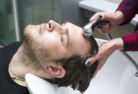 beauty salon face: The young man at the hairdresser salon hairstyle make model