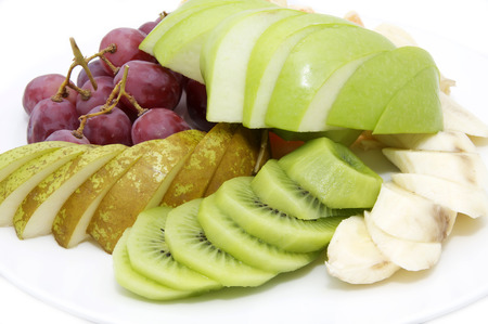 sliced fruit: large plate of sliced fruit on white background