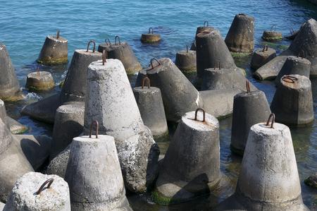 breakwaters: breakwaters made of concrete on the beach