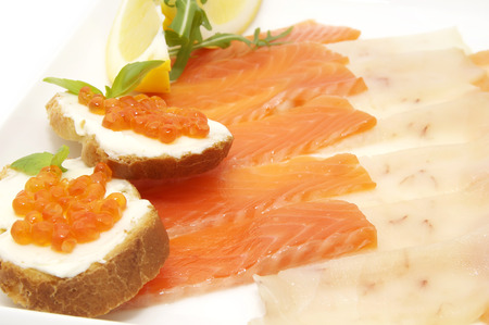 flesh eating animal: Sliced caviar sandwiches on white background