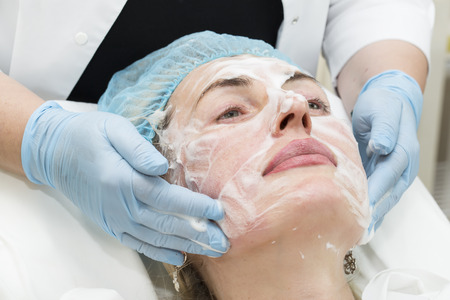 aging face: Cosmetic treatment with injection in a clinic Stock Photo