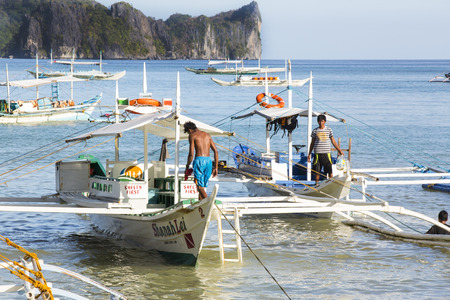 nido: El NIDO, PHILIPPINES - FEB. 16: Morning in the harbor fishing village of El Nido FEB. 16, 2016 in El Nido Philippines.