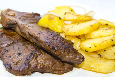 t bone: T Bone steak with potatoes and vegetables