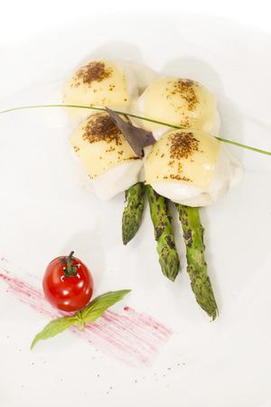 a portion: meatballs with asparagus Spicy Tasty Pork Portion