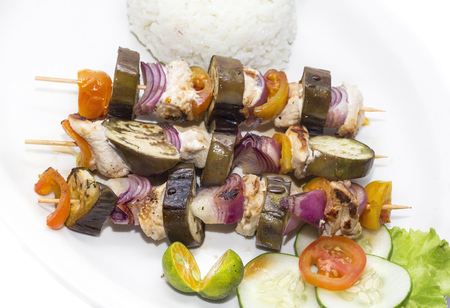 kebob: skewers of vegetables and chicken with rice and vegetables Stock Photo