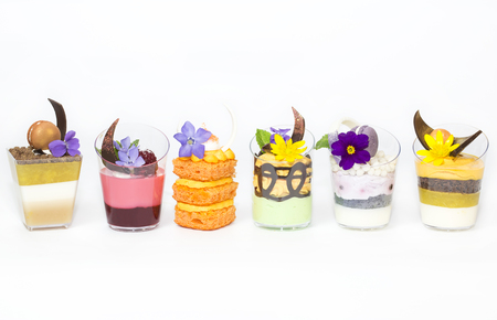 girdle: mini canapes in plastic cups decorated with edible flowers