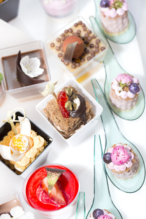 canapes: mini canapes in plastic cups decorated with edible flowers