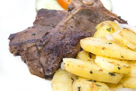 t bone: T Bone steak with potatoes and vegetables