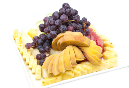 sliced fruit: a large plate of sliced ??fruit on white background