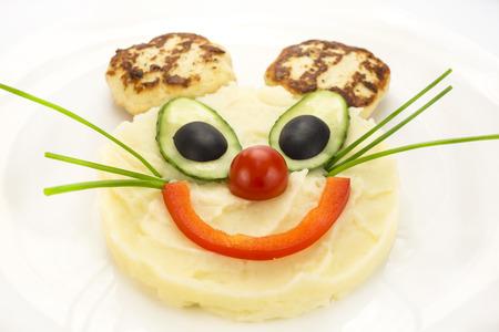 purè di patate in un topo con le orecchie delle costolette