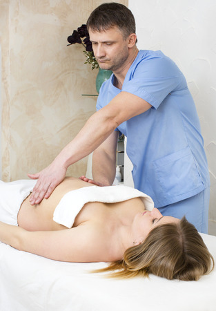 holistic care: processes salon doing massage to a pregnant woman