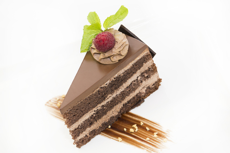 piece of chocolate cream cake on a white background in the restaurant