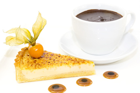piece of cake with passion fruit and a cup of hot chocolate Stock Photo