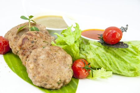 vegetable tin: vegetarian meatballs with salad on a white background in restaurant Stock Photo