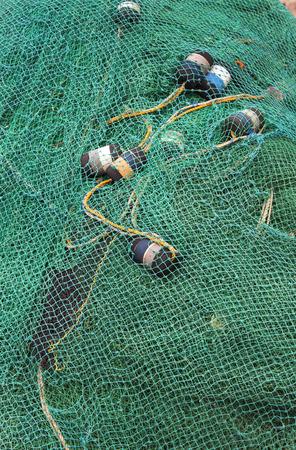 onshore: fishing net closeup photo onshore, outdoors, pattern Stock Photo