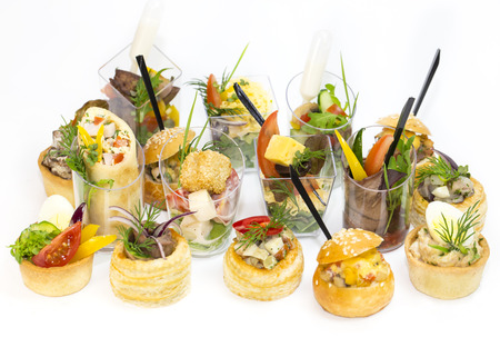 Canape with meat and vegetables in plastic cups