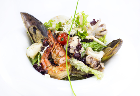 tunny: salad with vegetables and seafood on the table in a restaurant
