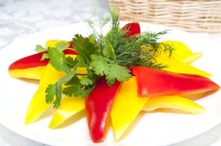 pimiento: Yellow peppers sliced ??on a white plate Stock Photo