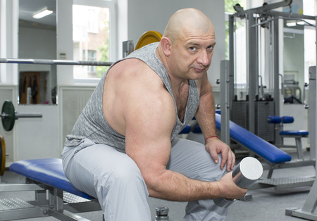 pectorals: adult brutal man is engaged in sports bodybuilding