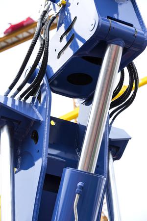 hydraulic hoses: chrome-plated hydraulic mechanism close-up shot Braid Mechanical