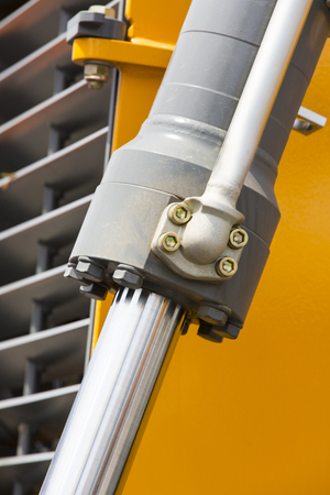 chromeplated: chrome-plated hydraulic mechanism close-up shot Machinery Piston