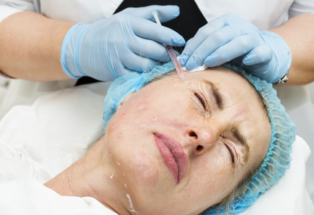 Cosmetic treatment with injection in a clinic Stock Photo