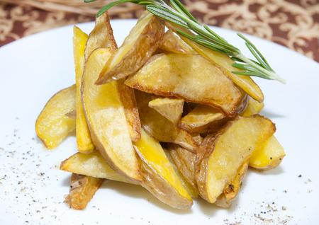 quartered: fried potatoes