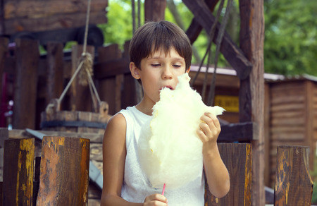companions: kids eating cotton candy Stock Photo