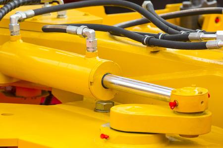 hydraulic hoses: chrome-plated hydraulic mechanism close-up shot Stock Photo