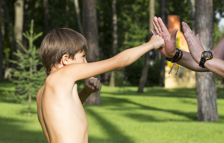 boy boxing: Boy and dad on the nature of boxing