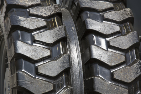 tyre tread: Background of a rubber wheel spikes shot closeup