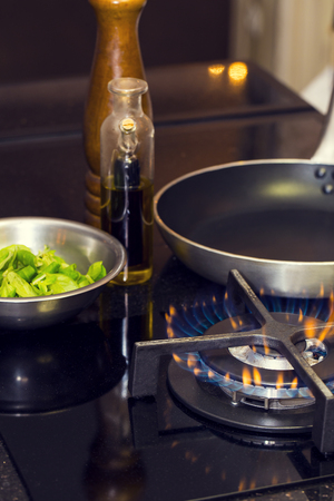 completed: table gas stove frying pan kitchen tools Stock Photo