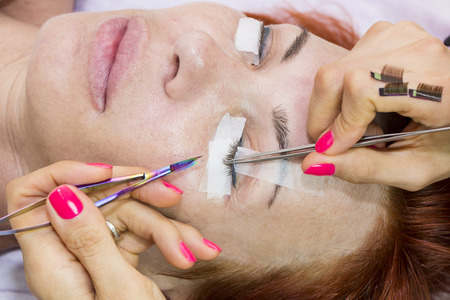 escalating: the application process in the beauty salon Stock Photo