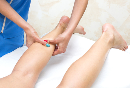 chiropodist: the process of foot massage treatments in the beauty salon