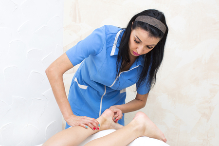 neuromuscular: the process of foot massage treatments in the beauty salon