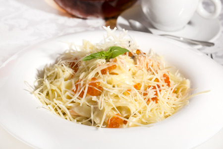 spaghetti with eggs decorated with greenery on a white background