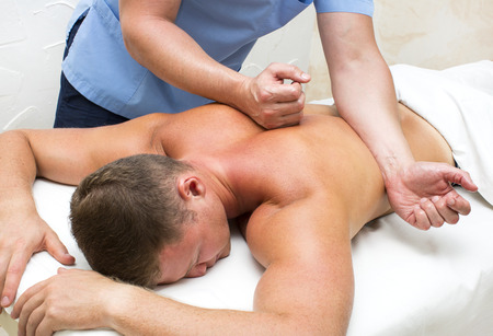 young man on wellness treatments sports massage Stock Photo